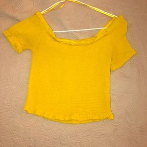 This is a yellow smocked crop top from forever 21!